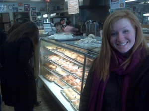 Chenault, in front of the pastries at Chiu Quon.